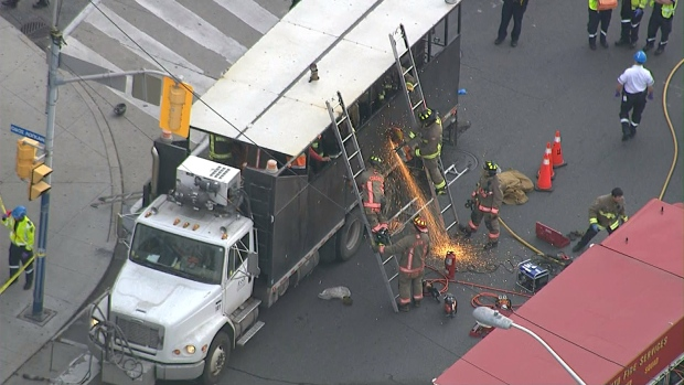 Worker scalded by tar after falling into back of tar truck