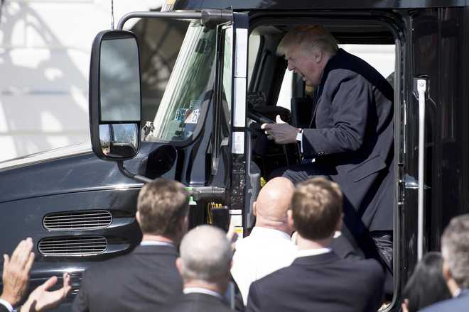 Trump pretends to drive truck at White House