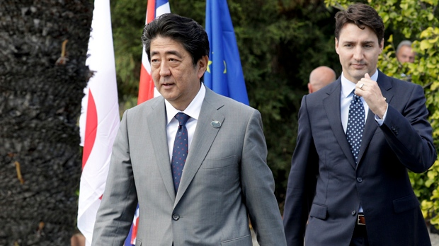 G7 leaders agree to fight protectionism, but U.S. hedges on Paris Agreement