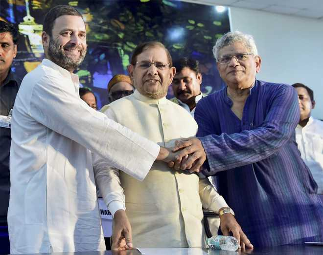 Opposition joins hands to fight BJP, preserve 'composite culture'