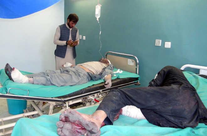 Suicide bombers, gunmen kill 47 in attacks on Afghan forces