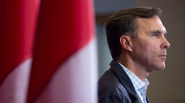 Morneau faces more questions despite promise to sell shares, use blind trust
